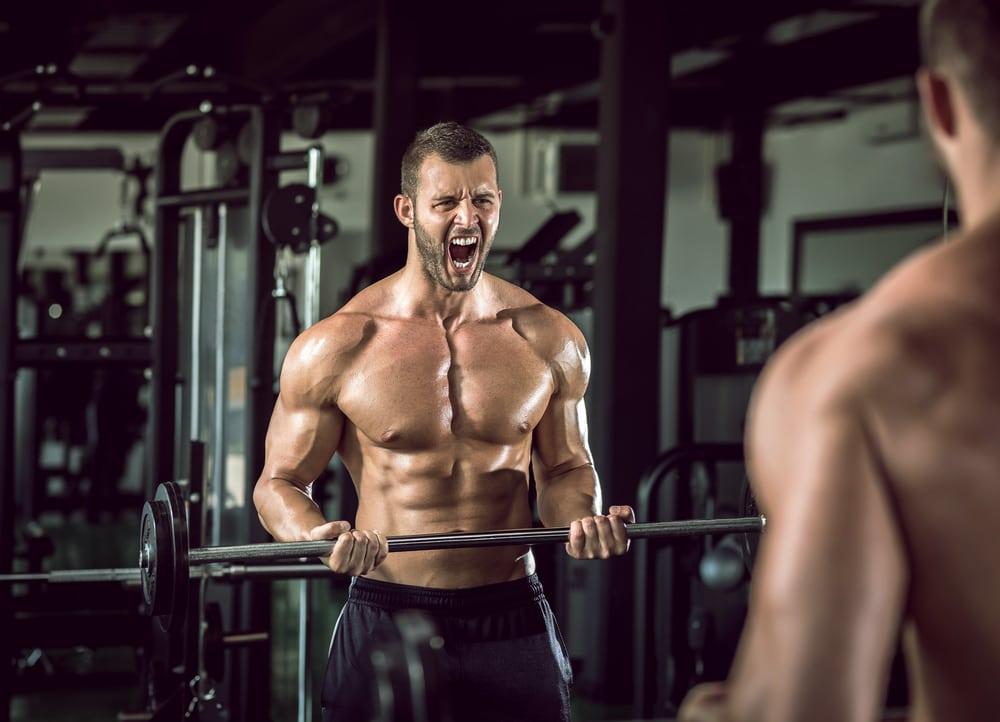 Bodybuilder lifting barbells