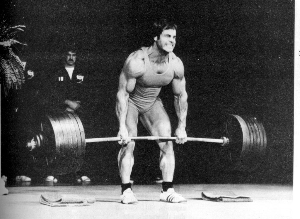 Picture of Franco Columbu showing his strength by deadlifting 727lbs