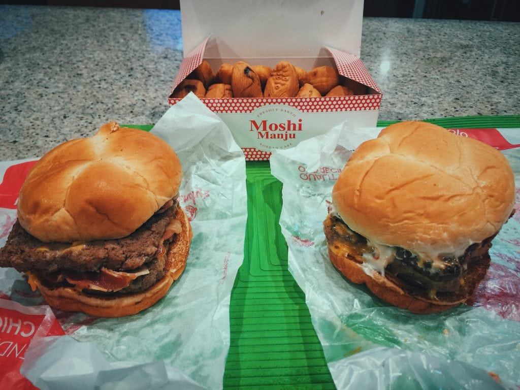 Photo of 2 burgers from Wendys and Moshi Manju. Know their calories, track them, and you'll have full control of your body weight